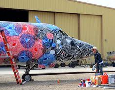 The Boneyard Project  Andrew Schoultz,  SPY TIGER, 2012,  acrylic on Lockheed V140 aircraft