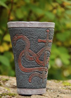 Ceramic Mug with carved viking pattern by Kvalka on Etsy.