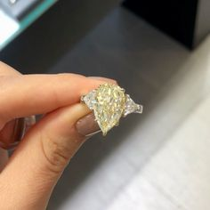 💎💛 F A N C Y  F R I D A Y 💛💎 This custom pear shape fancy yellow diamond ring was made for a very special client 💍 Can you guess the carat weight of the fancy yellow pear shape?! Check story today for all the details of how we created this stunning ring 🤩 - #laurenbjewelry #yellowdiamonds #ringgoals #pearshapediamond Yellow Diamond Rings, Pear Shaped Diamond, Heart Ring, Fancy, Engagement Rings, Detail, Check, Instagram Posts, Jewelry