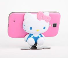 Hello Kitty Car Phone Stand. This is darling. My parents have been trying to get me out of the Hello Kitty phase since I was young, but I'm eighteen and still in love with Hello Kitty. <3
