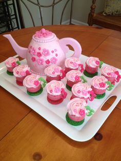Teapot cake with teacup cupcakes. The teacups are made with ice cream cups!