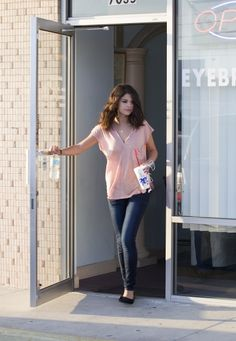 Selena Gomez stops off to get her nails painted at a nail salon .