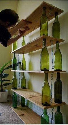 i could do this Quick & Dirty Repurposed Shelving Wine Bottles + wood + hardware tackle = crafty bookshelf. Empty Wine Bottles, Recycled Glass Bottles, Wine Bottle Art, Wine Bottle Crafts, Beer Bottles, Recycle Wine Bottles, Wine Bottle Fence, Waste Bottle Craft, Wine Bottle Candles