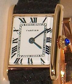 Such the classic!  Women's Solid 18K Gold Cartier Tank Designer Watch | eBay