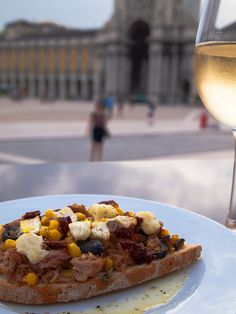 """A slice of toasted bread with Tuna  (with goat cheese, sweetcorn, black olives, sun-dried tomato, parsley and olive oil)"""""""