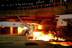 An employee works as molten metal flows for the first time at the new Hyundai Steel mill in Dangjin, about 123 km (76 miles) southwest of Seoul, South Korea on January 6, 2010. Hyundai Steel's first-ever integrated blast furnace has an annual production capacity of 4 million tons of steel products, Yonhap News Agency reported according to the company.(REUTERS/Hyundai Steel)