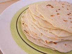 Soft Homemade Tortillas 2 cups flour - use unbleached white or whole wheat 1 t. sea salt 2 T. coconut oil (expeller-pressed variety for this recipe, since it doesn't have coconut flavor) OR lard 3/4 cup warm milk (or whey or even water)