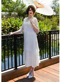 <p>Romantic vintage inspired ivory Art Nouveau dress is perfect for an informal garden wedding. If you love the femininity of Downton Abbey fashions then this is the dress for you! A wide brimmed hat, gloves and T straps or Mary Jane pumps will complete your ladylike turn of the century look!</p> <p>•Ivory rayon sleeveless chemise with an over dress of ivory embroidered tulle netting. <br />•Square cut neckline. <br />•La...