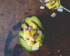 Even though guacamole is a summer staple, avocados are delicious year-round. And what better way to give cold weather the boot, than gorging yourself on grilled, bright, fresh flavors? If you don't feel like heating up the grill, mixing the avocado with the mango salsa also makes a killer guacamole.