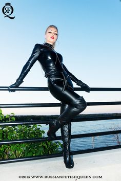 fabulous #RussianFetishQueen dressed in #sexy #black #leather #catsuit and wearing a #overkneeboots, seducing with her lovely #curves