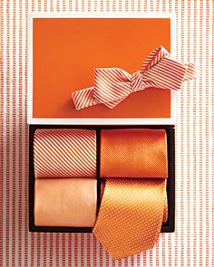 various orange ties and a bow tie