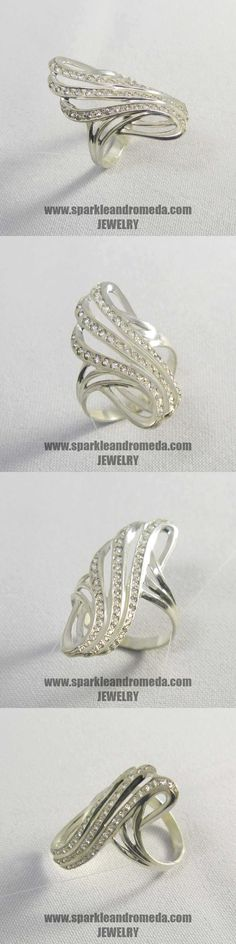 Sterling 925 silver ring with 18 round mm 20 round mm and 13 round 1 mm white color cubic zirconia gemstones.