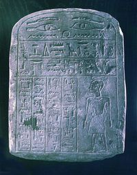 Hieroglyphics, carved on an ancient Egyptian stone tablet.