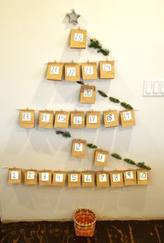 Add something new to your ideas for Advent with this Paper Bag Wall Advent Calendar. This DIY Advent calendar operates on a large scale. Number paper bags to represent each day of Advent and hang them on your wall with the help of string. Christmas Countdown Crafts, Christmas Tree Advent Calendar, Diy Advent Calendar, Christmas Bags, Diy Christmas Tree, Christmas Crafts For Kids, Holiday Crafts, Christmas Tables, Reindeer Christmas