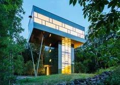 """Residential Architecture: Tower House by Gluck+: """"..This holiday home in upstate New York, USA, by US firm Gluck+ features an elevated living room that hovers nine metres above the ground..As the weekend retreat for Thomas Gluck – one of the firm's principals – and his family, Tower House was designed as a four-storey tower with a """"treetop aerie"""", affording mountain views across the nearby Catskill Park..The house is glazed on every side. In some placesGluck+has fitted dark green panels be..."""