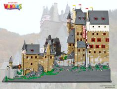 Rudolf von Eltz's small castle complex was developed in 1157, and built upon over 500 years to become the modern day Burg Eltz Castle, which sits nearly 100 metres above the surrounding valley in Germany. Our LEGO version was a real challenge, with almost no flat areas at all apart from the main castle, and even then there were multiple levels within it! To get the details we wanted to at the size we had, we ended up messing with the building's scale a fair bit, keeping it minifig scale at…