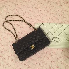 Chanel Classic Flap Bag Medium Caviar Chanel Classic Flap Bag Medium Caviar. I'm not quite sure of the authenticity as this was a gift from an aunt. But I checked it side by side with an authentic one and I didn't see any difference  make me an offer  CHANEL Bags Shoulder Bags