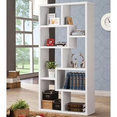 This wall unit can be used to dress up any wall with the look of interlocking shelves, which provide storage and display space in different sized compartments.