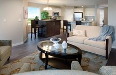 Luna Showhome in Walker Summit this smaller space combines a modern kitchen with more traditional furniture to make it feel new and comfortable Morrison Homes, Traditional Furniture, New Homes For Sale, Home Builders, Small Spaces, Floor Plans, Vibrant, Design Inspiration, Couch