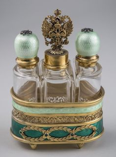 Faberge Style Silver and Enamel Perfume Set * : Silver gild tray, with three glass bottles, green guilloche enamel decoration, jewel accents. Overall, height 5 inches. Antique Perfume Bottles, Vintage Bottles, Parfum Mademoiselle, Faberge Eier, Beautiful Perfume, Objet D'art, Glass Bottles, Fragrance, Vintage Silver