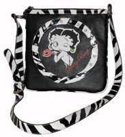 """This Betty Boop Messenger bag has the following features  Rhinestones and zebra trim Long adjustable strap Famous Betty featured on front Fully lined interior Inner open pocket  Approximate Size: 10.5""""L x 10.5""""H x 0.5""""W"""
