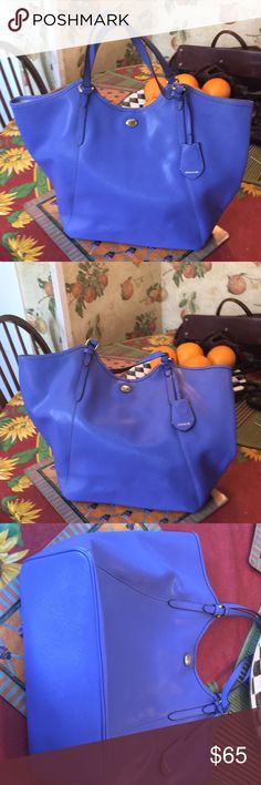 Coach periwinkle leather tote Gorgeous color Coach brand leather tote.  2 handles can be worn over the shoulder.  Just a beautiful piece! Coach Bags Totes