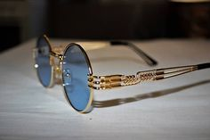 Sunglasses design recalls Gaultier, Matsuda. Frame gold, Lens blue . South Korea Manufacturing.