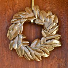 Gold Magnolia Wreath using foam/wreath form, magnolia leaves, and spray paint