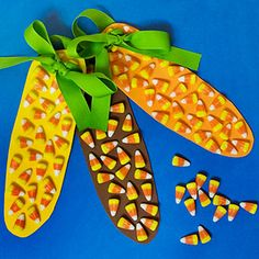 """Candy Corn on the Cob""  Cut out corncob shapes out of craft foam or heavy construction paper and paint them orange, yellow, and brown. Glue candy corn on them, punch two holes in the top of each ear and string a green ribbon through them to tie them all together."