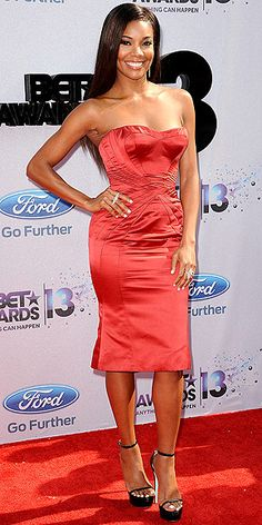 BET Awards 2013: Gabrielle Union in a strapless Zac Posen red sating dress with black strappy platform pumps.