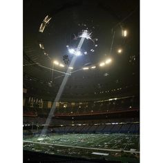 September 5, 2005: A shaft of light falls through an opening in the fully evacuated Superdome in New Orleans