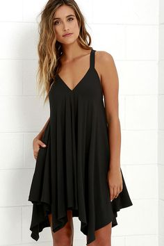 Dominate the style scene wherever you go with the Jack by BB Dakota Domani Black Swing Dress! A wide, swinging silhouette is shaped by lightweight woven rayon that falls from thick straps. Racerback and hidden side-seam pockets bring a tailored touch to this easy-to-wear dress.