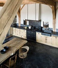 Rustic Kitchen with Soapstone, Inset cabinets, custom soapstone farmhouse sink, Concrete floors, L-shaped, Soapstone counters