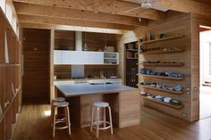 In this Australian kitchen, warm, local tallowwood covers nearly every surface.