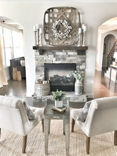 How cozy is this sitting area?We're obsessed with this central fireplace that's built right in the middle of the downstairs floor plan! Tonight would be a perfect night to cuddle up to a lit fireplace! Foyers, Decoraciones Ramadan, Fixer Upper Style, Tobacco Basket Decor, Wood Basket, Joanna Gaines Decor, Joanna Gaines Living Room, Country Farmhouse Decor, Farmhouse Style