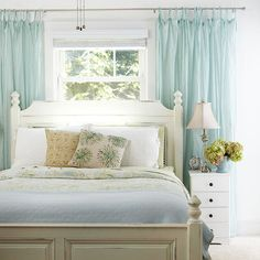 small bedroom solutions - bed in front of window (more wall space for dressers) and long curtain rod across wall with curtains to the sides (makes window feel bigger)
