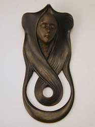 Art nouveau lady doorbell cover--if I ever take a pottery class again, I might have to try to do something similar.