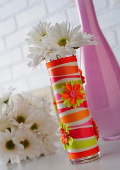 Mod Podge a small glass bud vase with a piece of scrapbook paper