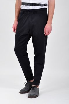 Neil Barrett Sweat Pants Black  Black sweat pants made from cotton jersey and featuring double stitch detailing at the fly, crotch and back. Completed with elasticized waist with inner drawstring closure and a tapered leg ending with a cuff. Two side pockets. Relaxed and cool.  › Made in Portugal  › 90% Cotton  › 10% Elastane  i want these now.
