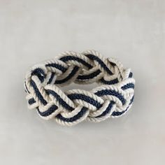 I like that this bracelet is simple yet the color contrast makes it more complex. This is the quintessential summer bracelet.