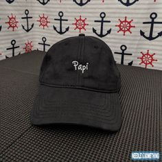 """Show Papi some love!  Our embroidered coated Black """"Papi"""" 6-panel hat/cap is the perfect way to show your love and support to that big strong man in your life.    #Papi #Daddy #Dad #Papito #Father #Embroidered #Hats #Gifts #Cute #Black"""