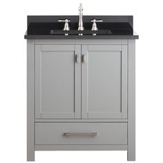 The Modero 30-inch vanity has a simple clean design with a chilled grey or black finish and brushed nickel hardware. It is constructed of solid poplar wood and veneer with soft-close doors and drawers that showcase its quality.