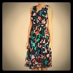 🆕 Flower Botanical Dress NWT! This fun, springtime dress goes from ordinary to extraordinary when its ruched, surplice-wrap bodice and flouncy, full-skirt are beautifully splashed with an abstract floral print. The bow-adorned waistband breaks up the pattern in a monochrome finish that accentuates the slenderest part of the body.                                     -Bow-decorated waistband -Set-in waist -Invisible back zip -Shirring at shoulder, waist and under bust -Fully lined -Length…