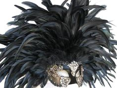 one of my favorite feather masks. i love the contrast on the mask itself