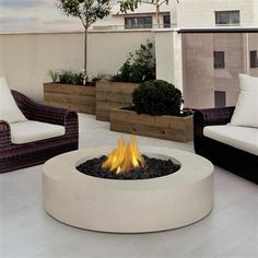 Define your outdoor space with the clean design of a Real Flame Mezzo Round Outdoor Fire Pit. Cast from a high performance, lightweight fiber-concrete with an outdoor safe finish, this fire column comes complete with lava rock filler, and a matching lid for when the burner is not in use. All Real Flame propane products carry a CSA Certification and feature an electronic ignition.