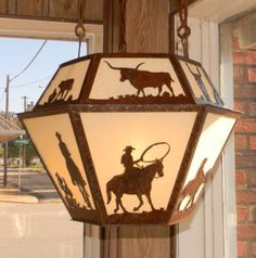 Cherokee Iron Works | Rustic & Western Lighting | Rustic & Western Chandeliers | Rustic & Western Home Decorations - Texas Cowboy  This is where we purchased our lighting!  He does amazing work!!!