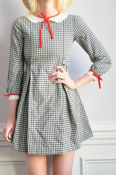 Checked Dress by Fancy Treehouse.  I'd like this on a child, but it looks funny on those curves.  Needs some alteration or a different bra.