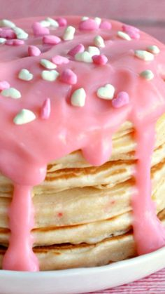 Valentine's Day Cherry Chip Pancakes with Cheesecake Sauce Recipe ~ oh-so-pretty pink pancakes made with a cherry chip cake mix batter and a sweet pink cheesecake pudding topping.