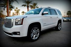 2015 GMC Yukon Denali - Nice looking city vehicle. Would hold five people without a problem. Lot's of cargo room too. Fairly good gas mileage.
