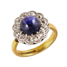 Tiffany & Co Cabochon Sapphire & Diamond Cluster Ring, set in 18K white gold with 18K yellow gold band.